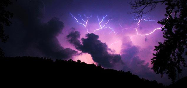 Lightning in a dark purple sky over the Allegheny Forest