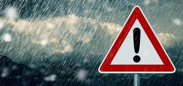 Sign with exclamation point in the rain